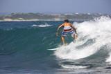 Adrenaline seeking surfer surfing in the ocean poster