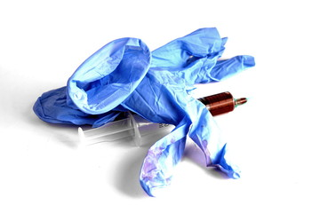 Studio shot of blue surgical gloves end medical intruments