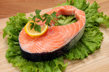 served piece of fresh salmon steak