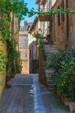 Beautiful colorful streets of the Tuscan town on a sunny day - 83034159