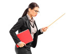 Angry female teacher swinging with a stick