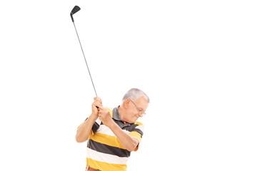 Profile shot of a senior playing golf