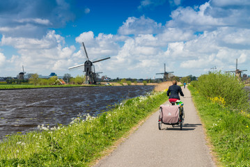 Dutch windmills with canal reflections at Kinderdijk, Netherland