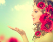 Beauty girl with red poppy flowers hairstyle and open hands