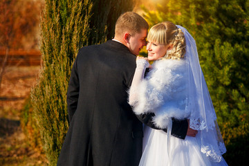 Happy young bride and groom on their wedding day. Wedding couple