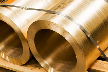 Industrial hardened steel cylinders in workshop. Industry.