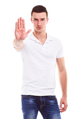 Young man makes a gesture stop