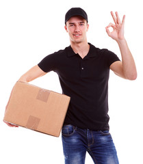 Delivery man holding a cardboard box