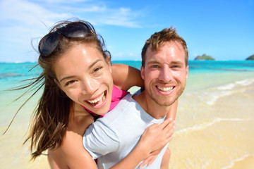 Happy beach couple in love on summer vacations