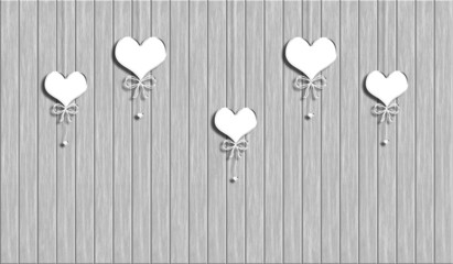 Hearts on a rope on the  abstract wooden background
