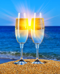 Glasses with champagne near the sea