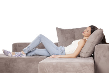 a beautiful young woman lying on the couch and sleeping