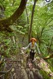 Redhead woman walking on a mountain trail