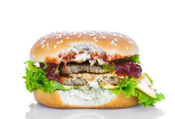 Bitten hamburger on white background