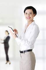 Businesswoman with tablet.