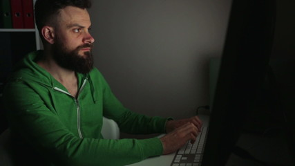 Beared man working at a computer