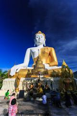 Buddha Statue with prayers. Wat Phra That Doi Kham. Chiang Mai