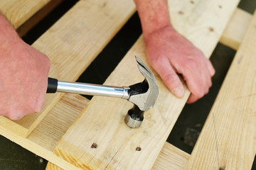 Carpenter using a claw hammer