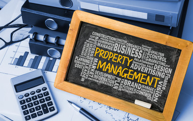 property management with related word cloud handwritten on black