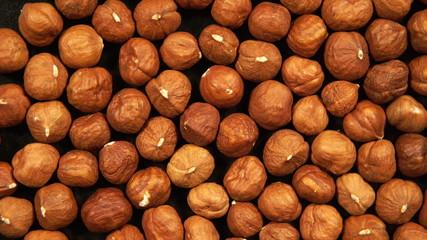 Peeled hazelnut kernels is circling