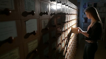 Searching in archives. Silhouette Student searching from a