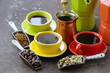 green, black coffee beans and utensils for boiling coffee