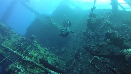 Freediver dives on the wreck Giannis D, Red Sea