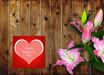 Mothers day card with pink Lily flower on wooden board