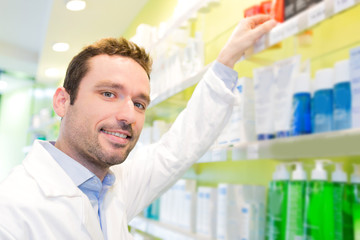 Attractive pharmacist clean the store up
