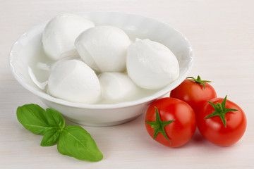 mozzarella cheese, cherry tomatoes and basil leaf