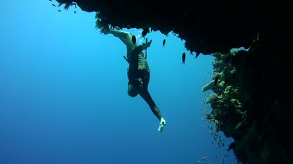 Freediver dives near the coral reef, Red Sea, Egypt