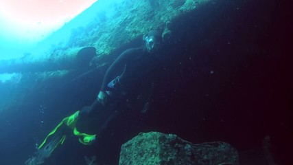 Freediver dives on the wreck SS Thistlegorm,