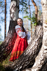 Beautiful womanl in a russian national dress outdoors