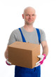 young man with bald head and cardboard