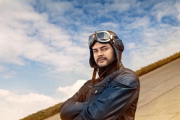 Retro Pilot Portrait with Glasses and Vintage Helmet