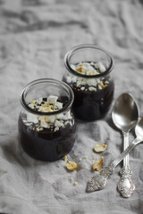 chocolate pudding with meringue crumbs and nuts