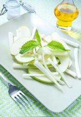 Fresh salad and green celeriac, celery and green apple
