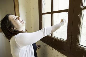 Girl breaking window