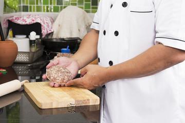 Chef present Hamburger patty brfore cooking
