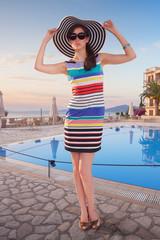 Woman posing near a hotel