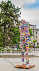 Street art design covered in clothes rags imitating a human
