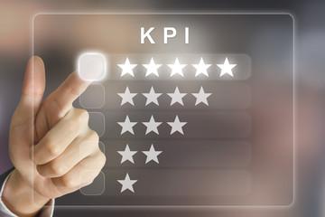 business hand pushing KPI or Key Performance Indicator on virtua