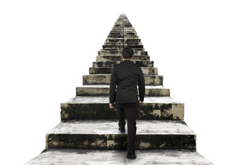 Businessman climbing the old concrete stairs isolated on white