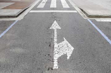 Directional arrows on the asphalt