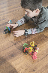Child playing with small toys