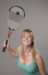 Female squash player with raquet and ball