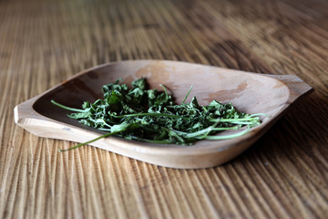 Dried herbs in wooden bowl