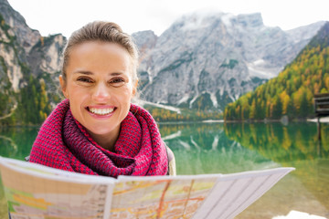 Portrait of smiling brunette at Lake Bries holding map