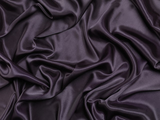 Black shiny silky fabric background
