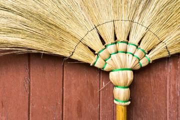 Broom Stick Lay on a Brown Wooden Door